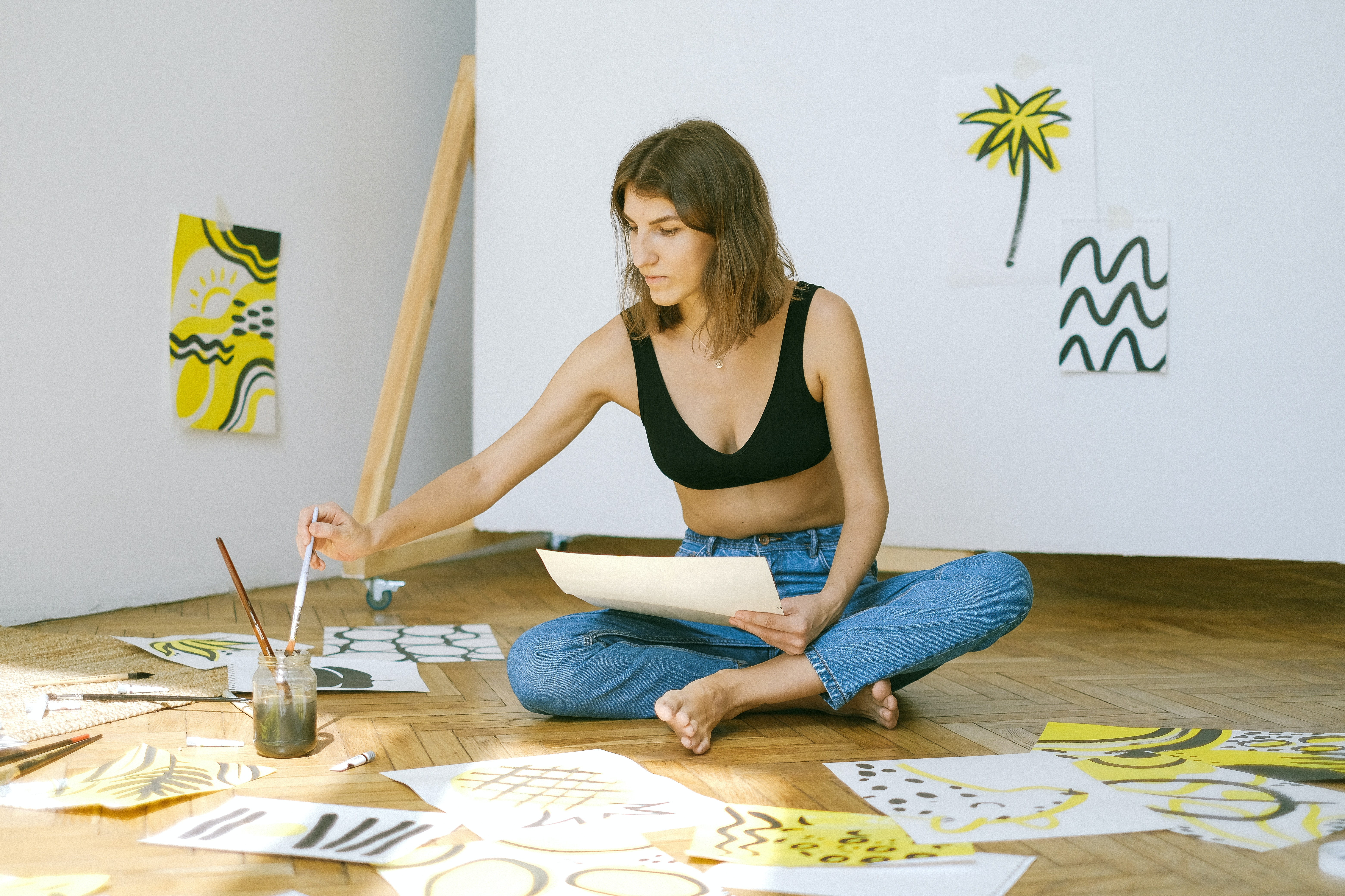 photo-of-woman-sitting-on-floor-while-painting-4483167